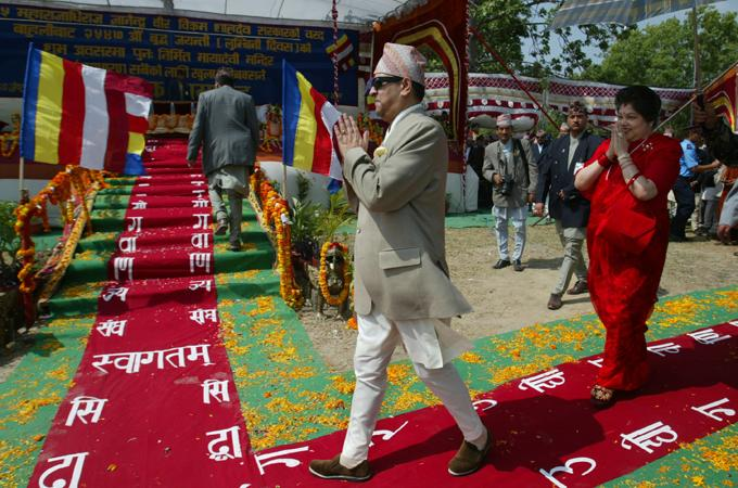 Former Nepalese King Gyanendra walks on the red carpet in Lumbini along with Queen Komal Raiya Laxmi Devi Shah [Getty]