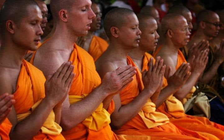Buddhist monks engage in the art of meditation at Mendut Temple, Indonesia CREDIT: GETTY IMAGES